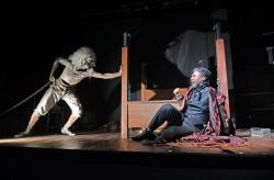 """Taavon Gamble as Jacob Marley (left) and Jude Sandy as Ebenezer Scrooge in """"A Christmas Carol"""" at the Trinity Repertory Company. (Photo by Mark Turek)"""