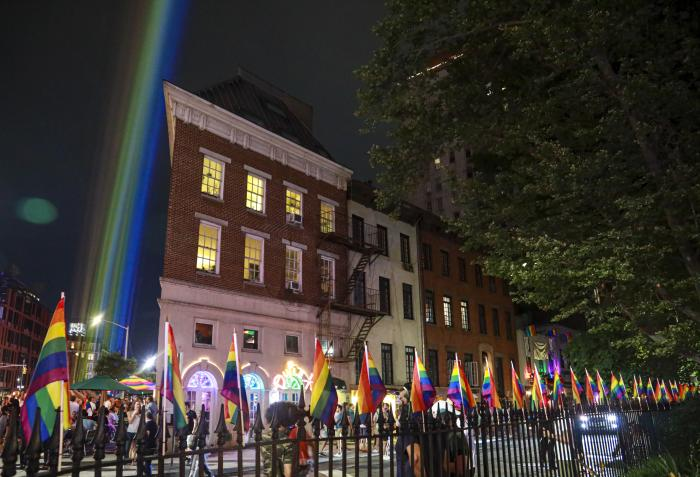 A rainbow light display illuminates the night sky in the West Village near The Stonewall Inn, birthplace of the gay rights movement, Saturday, June 27, 2020, in New York.