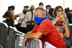 In this Tuesday, June 23, 2020 file photo, a voter waits in line at Kroger Field to cast his ballot in the Kentucky primary in Lexington, Ky.