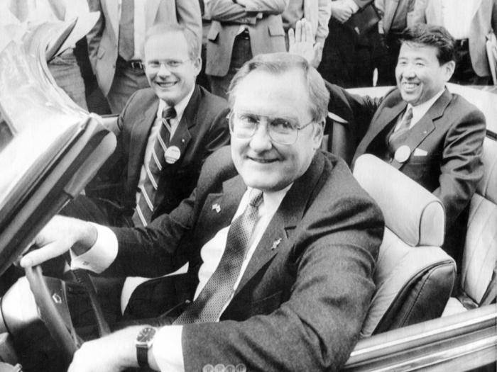 In this Oct. 7, 1985 file photo, Illinois Gov. James R. Thompson, behind the wheel of a Chrysler convertible, is joined by G. Glenn Gardner, left, and Yoichi Nakane, after a news conference in Chicago