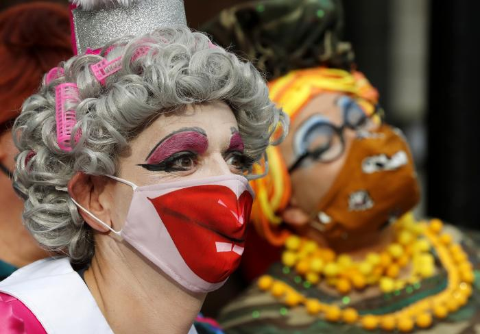 Actors dressed as pantomime dames pose for photographers as they march on Parliament to demand more support for the theatre sector amid the COVID-19 pandemic in London.