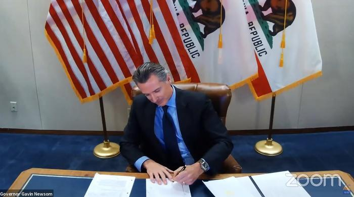 California Gov. Gavin Newsom signs into law a bill that establishes a task force to come up with recommendations on how to give reparations to Black Americans in Sacramento, Calif.
