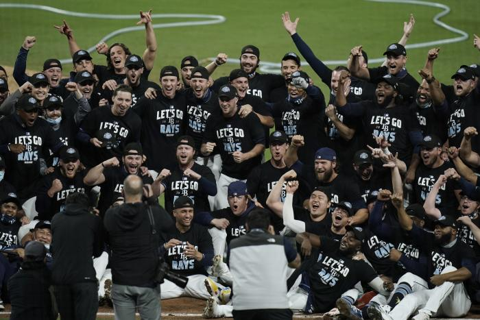 The Tampa Bay Rays celebrate after defeating the New York Yankees 2-1 in Game 5 of a baseball AL Division Series, Friday, Oct. 9, 2020, in San Diego. (AP Photo/Jae C. Hong)