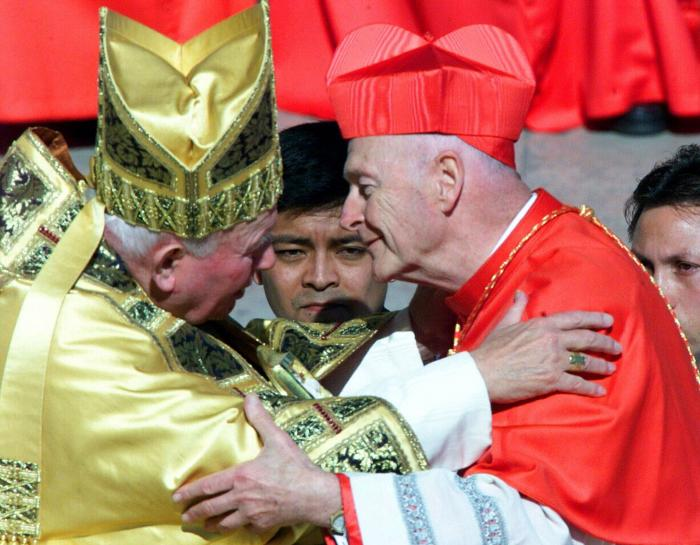 In this Feb. 21, 2001 file photo, Cardinal Theodore Edgar McCarrick, archbishop of Washington D.C., wearing the three-cornered biretta hat, embraces Pope John Paul II in St. Peter's Square at the Vatican.