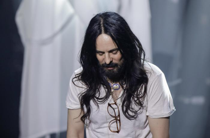 In this Wednesday, Feb. 19, 2020 file photo, Designer Alessandro Michele acknowledges the applause at the end of Gucci's Fall/Winter 2020/2021 collection, presented in Milan, Italy.