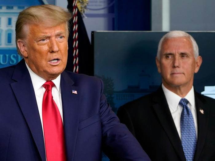 In this Nov. 24, 2020, file photo President Donald Trump speaks in the press briefing room as Vice President Mike Pence listens in Washington