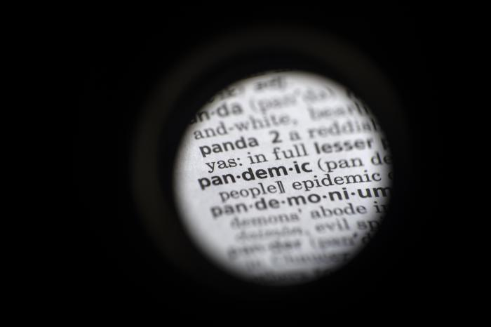 """The word """"pandemic"""" in seen in a dictionary in Washington."""
