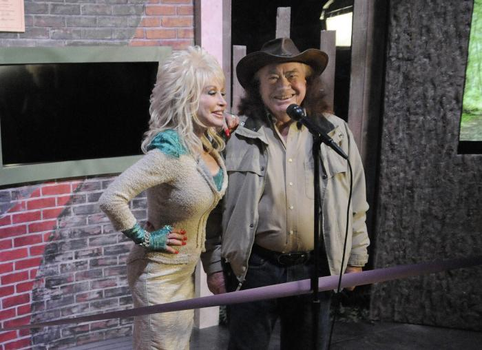 Country music legend Dolly Parton, left, stands with her uncle Bill Owens during a sneak peek preview at Dollywood in Pigeon Forge, Tenn.