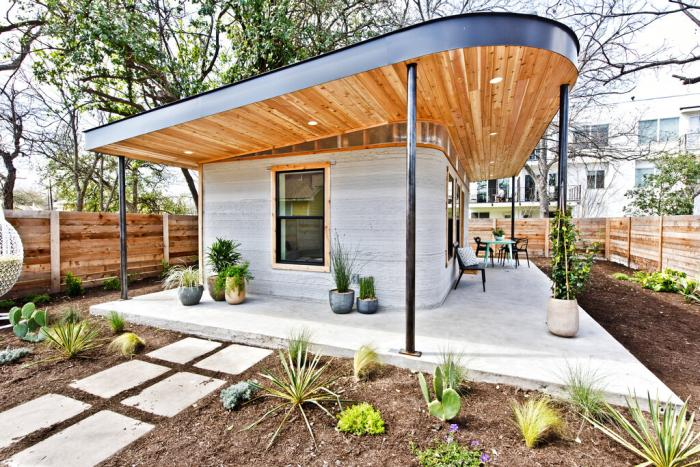 This photo provided by ICON shows one of its 3D-printed homes in Austin, Texas.