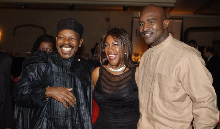 In this Feb. 20, 2003 file photo, Lloyd Price, left, and Mary Wilson, of the Supremes, pose for a photograph with boxer Evander Holyfield during the reception of the 13th Annual Pioneer Awards presented by the Rhythm & Blues Foundation in New York.