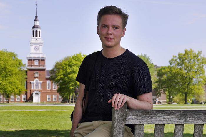 Colin Goodbred, a 22-year-old transgender student, poses on the campus of Dartmouth College, Friday, May 21, 2021, in Hanover, N.H.