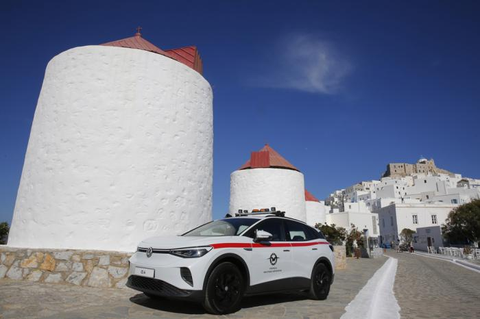 A Volkswagen ID.4 electric car of the Civil Aviation is parked on the Aegean Sea island of Astypalea, Greece during the official launch of a project to introduce and test electric vehicles and sustainable energy systems on Wednesday, June 2, 2021