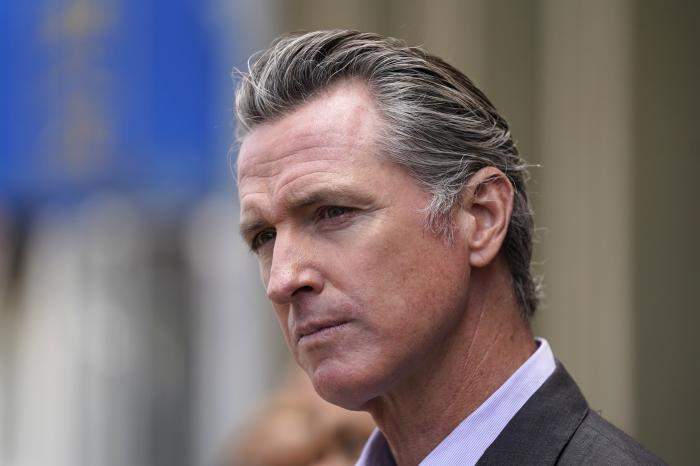 In this June 3, 2021 file photo, California Gov. Gavin Newsom listens to questions during a news conference outside a restaurant in San Francisco.