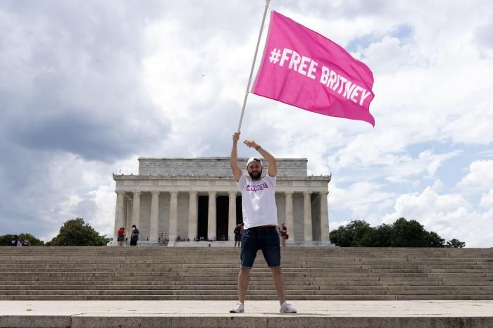 """Fans and supporters of pop star Britney Spears protest at the Lincoln Memorial, during the """"Free Britney"""" rally, Wednesday, July 14, 2021, in Washington."""