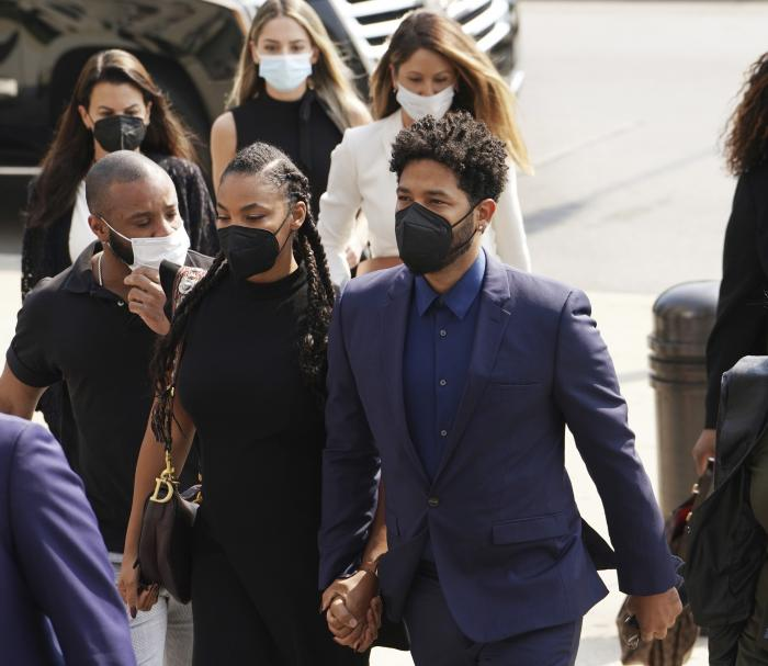 """Former """"Empire"""" actor Jussie Smollett, right, arrives the George N. Leighton Criminal Court Building for a hearing in Chicago."""