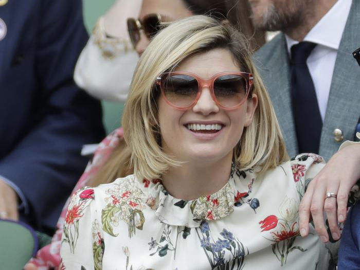 In this file photo dated Saturday, July 13, 2019, actress Jodie Whittaker sits in the Royal Box on Centre Court to watch the women's singles final match between Serena Williams of the United States and Romania's Simona Halep on day twelve of the Wimbledon Tennis Championships in London
