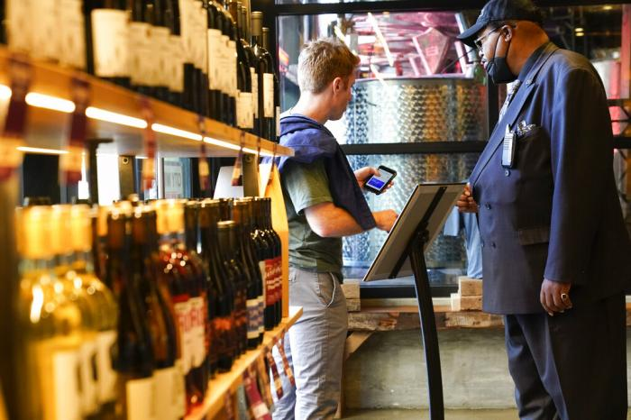 Security personnel ask customers for proof of vaccination as they enter City Winery.