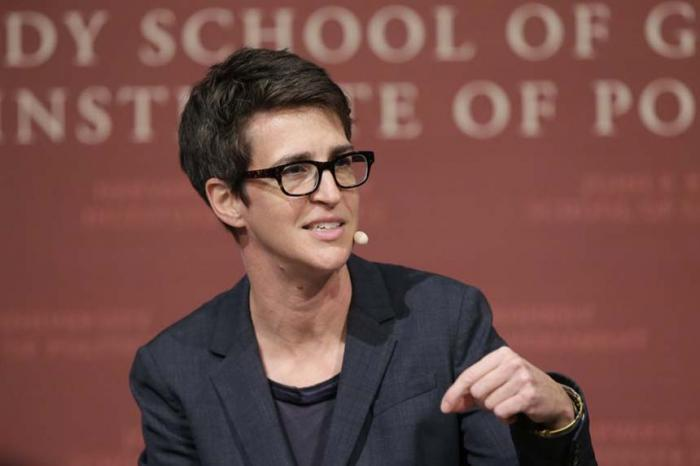 """In this Oct. 16, 2017 file photo, MSNBC television anchor Rachel Maddow, host of """"The Rachel Maddow Show,"""" moderates a panel at a forum called """"Perspectives on National Security,"""" at the John F. Kennedy School of Government, at Harvard University, in Cambridge, Mass."""