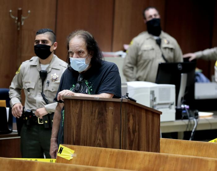 In this Tuesday, June 23, 2020, file photo, adult film star Ron Jeremy, second from left, makes his first court appearance in Los Angeles.