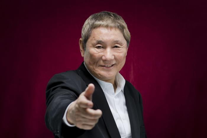 """In this Sept. 8, 2017, file photo, Japanese director Takeshi Kitano poses for portraits for the film """"Outrage Coda"""" at the 74th edition of the Venice Film Festival in Venice, Italy."""